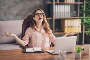 Professional woman sitting at laptop